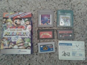 Examples of some of the media the GBA can play including e-Reader cards, GBA games and videos, and original and Game Boy Color games.